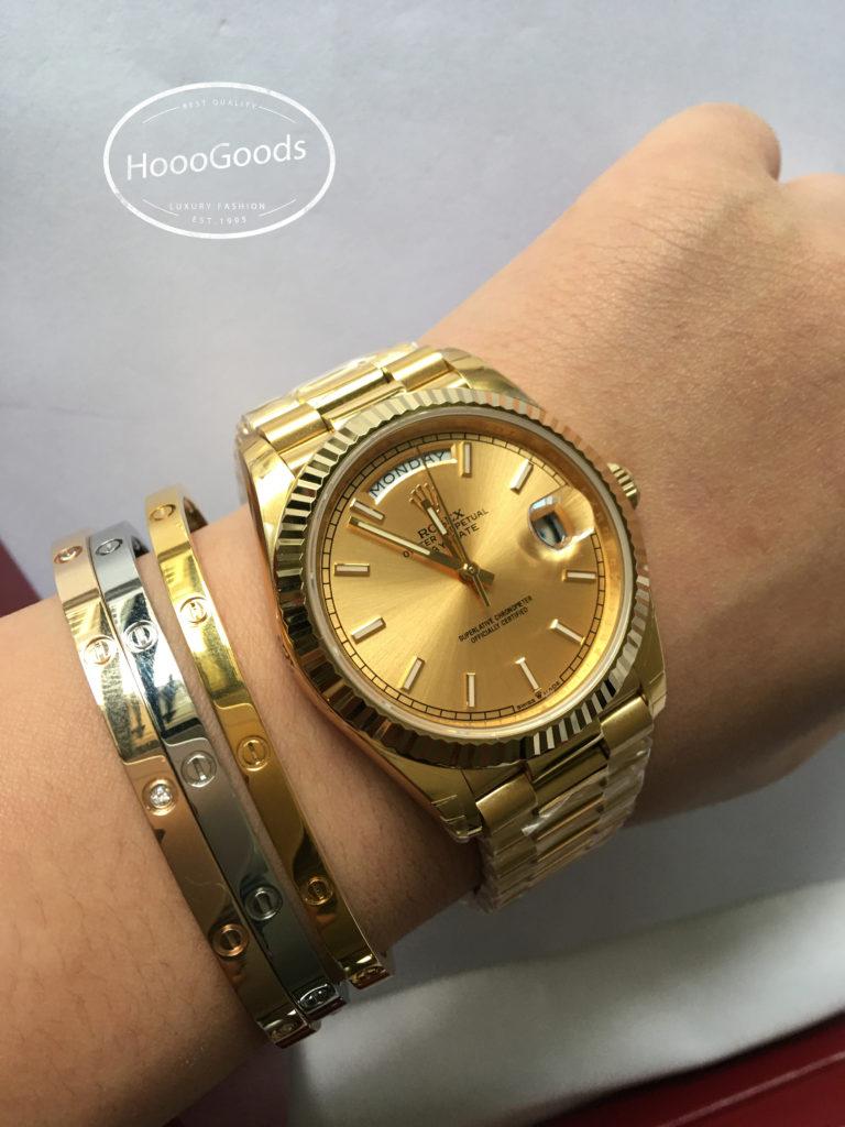 Stackable Cartier love bracelets with Rolex watch