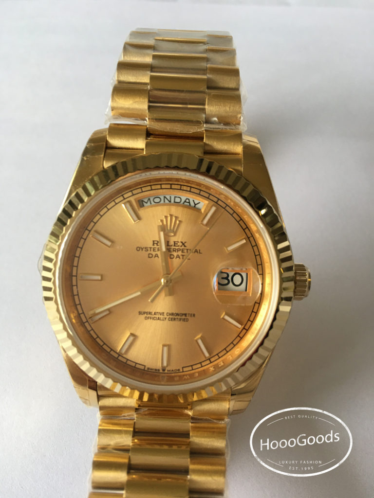 Classic Rolex Watch Oyster Perpetual Day-Date 40 in yellow gold with a champagne-colour dial, Fluted bezel and a President bracelet