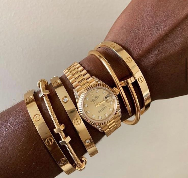 Stacking Ideas: Cartier love bracelet, Cartier Juste un Clou bracelet and rolex watch