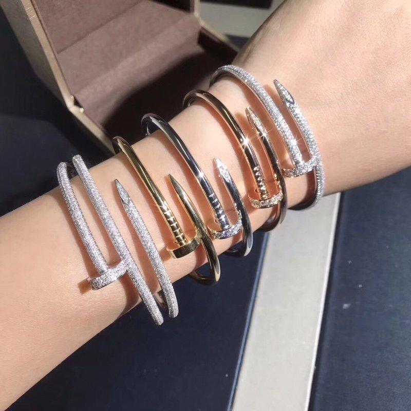 Stacking Ideas: Wearing Multiple Cartier Juste un Clou bracelet diamonds