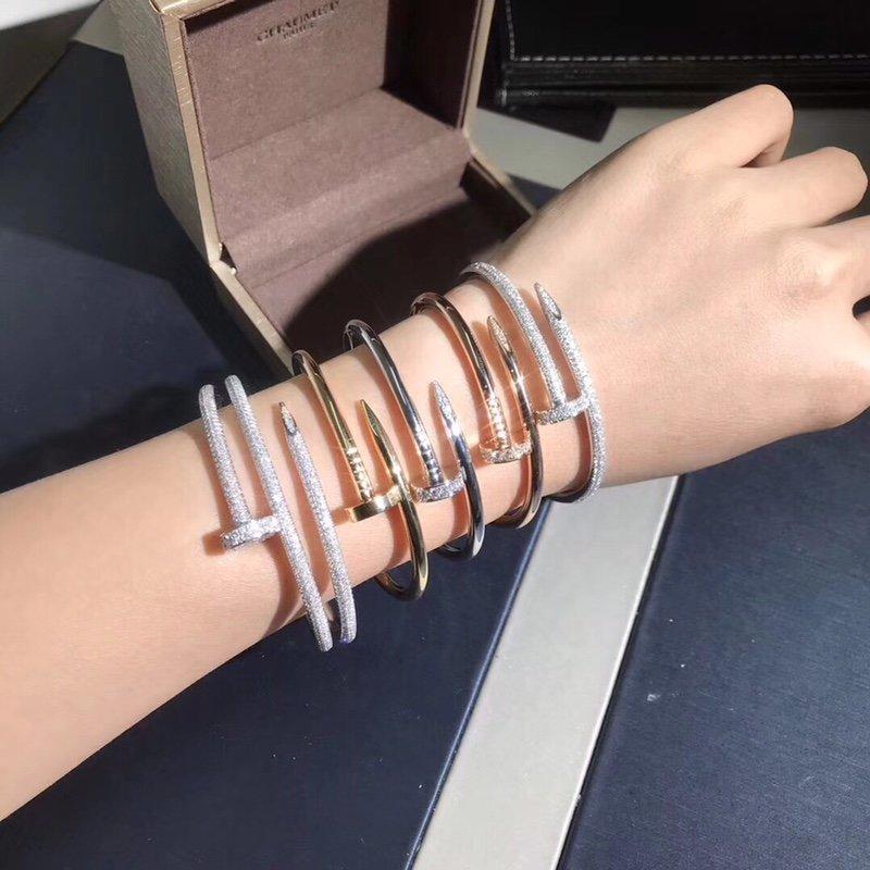 Wearing Multiple Diamond Cartier Nail bracelets