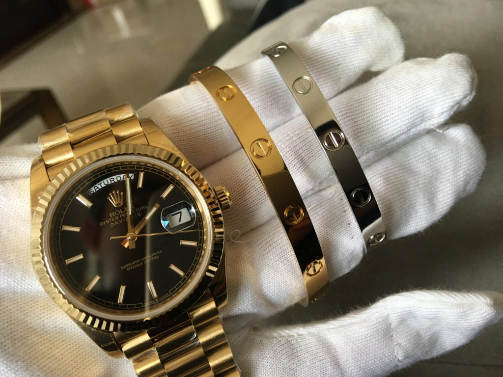 Rolex Day-Date 40 Watch black and gold & Cartier love bracelet