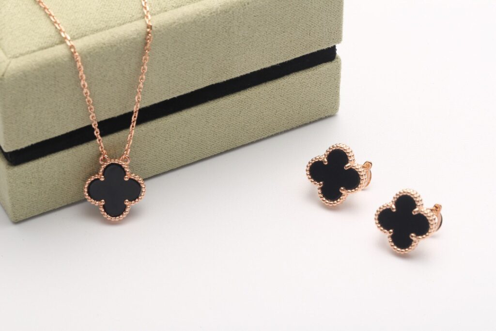VCA Vintage Alhambra earrings and necklace rose gold.  Onyx