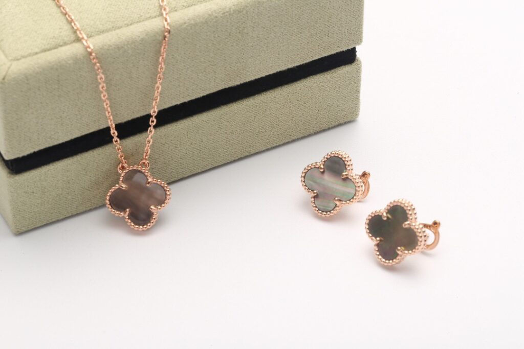 VCA Vintage Alhambra earrings and necklace rose gold.  Mother-of-pearl