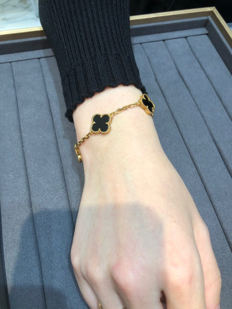 Yellow gold, Onyx. Van Cleef Vintage Alhambra bracelet, 5 motifs