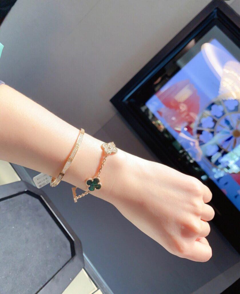 Stacking: VCA bracelet and Cartier Love bracelet