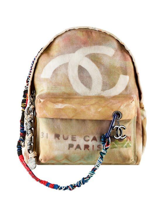 Beige Chanel Graffiti printed canvas backpack